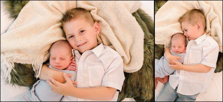 Sibling shot newborn